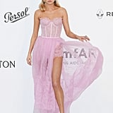 """Pretty in pink with a sexy twist is how I would describe Elsa's amfAR Gala dress by Ermanno Scervino. My favorite part has to be the lace embroidered train, which seemed light and airy."" — ML"