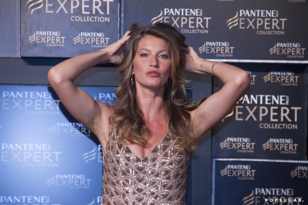 Gisele Bündchen played with her hair at a photocall promotion for Pantene Expert.