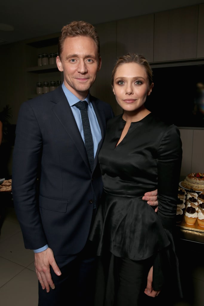Elizabeth Olsen and Tom Hiddleston, who have appeared to be more than friends recently, stepped out together for the premiere of I Saw the Light at the Toronto International Film Festival on Friday. The happy twosome was in good spirits, flashing cheeky smiles, posing for photos, and even goofing around with a cake. While neither Elizabeth nor Tom has confirmed they're in a romantic relationship, Us Weekly reported the two started hooking up back in May after playing husband and wife in I Saw the Light. Keep scrolling for more snaps from the pair's glamorous night out.