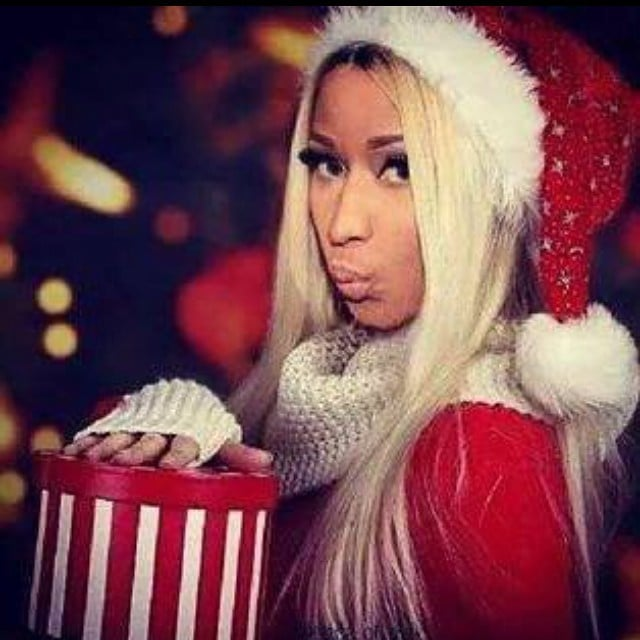Nicki Minaj dressed up in a sultry Santa suit. | Celebrities on ...