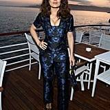 Salma Hayek showed up to the Vanity Fair and HBO Dinner in a shiny blue and black jumpsuit.