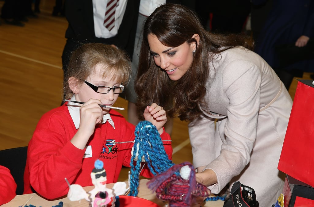 Kate checked out a little girl's art project during a November 2012 visit to the Manor School in Cambridge, England.