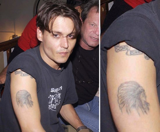 """In 1989, Johnny Depp underwent the needle to get """"Winona Forever"""" tattooed on his right arm. After the duo's split, it looked like Johnny had it changed to """"Wino Forever."""""""