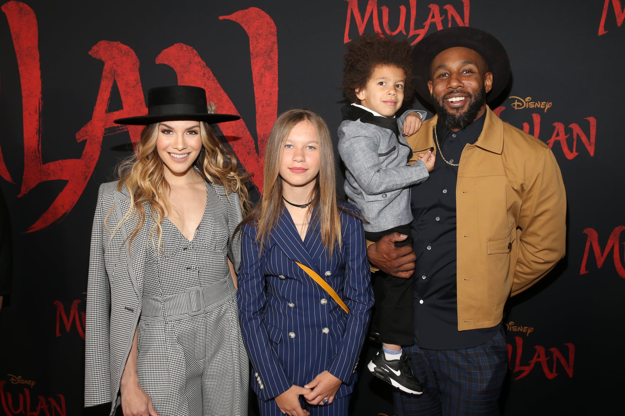 HOLLYWOOD, CALIFORNIA - MARCH 09: (L-R) Allison Holker, Weslie Fowler, Maddox Laurel Boss, and Stephen Boss attend the World Premiere of Disney's 'MULAN' at the Dolby Theatre on March 09, 2020 in Hollywood, California. (Photo by Jesse Grant/Getty Images for Disney)
