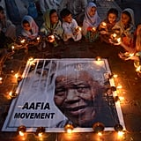 People gathered in Pakistan for a candlelight vigil.