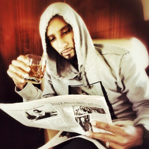 Swizz Beatz enjoyed a drink while reading the newspaper. Source: Instagram user therealswizz