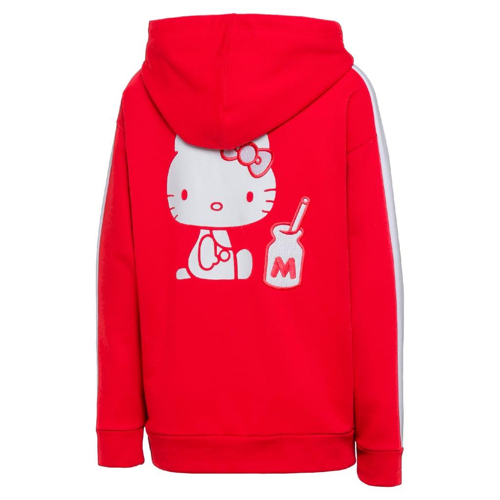 """""""تي-7 هودي"""" PUMA x Hello Kitty، بسعر 335 درهماً إماراتيّاً"""