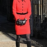 Sixteen years later Kate chose a very similar ensemble — but by in red and by Louisa Spagnoli — for a trip to her former university St. Andrews.