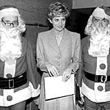 Diana was wedged between two Father Christmases during a charity visit in 1992.