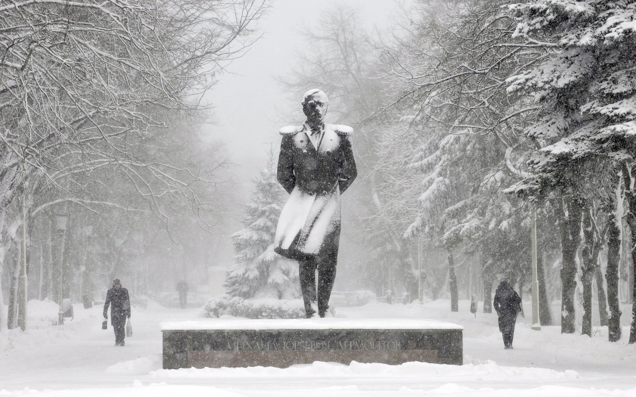People in Stavropol, Russia, walked past a snow-covered monument to Russian poet Mikhail Lermontov.