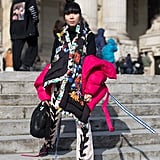 Susie Lau wore a red puffer on top of her rainbow coat.