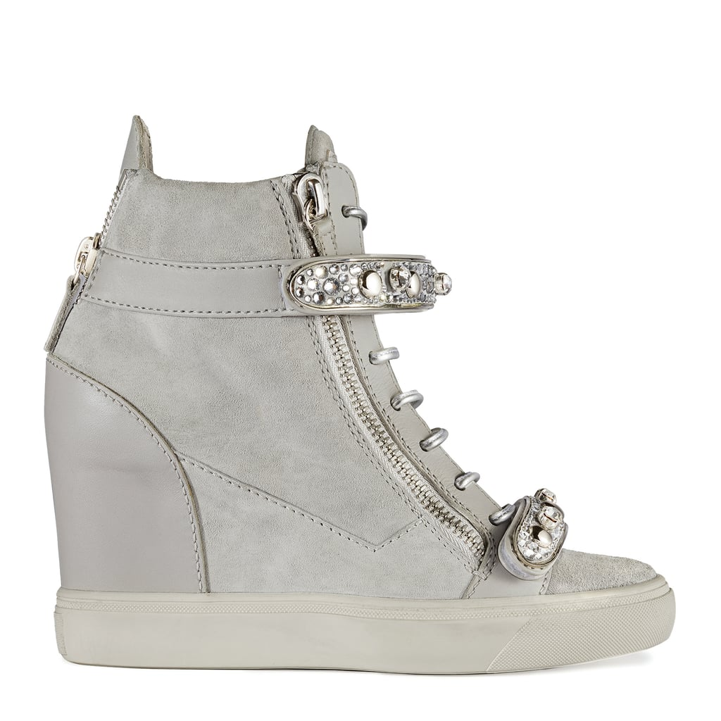 Inspired by Jennifer's cousin, the Tiana sneaker ($1,395) features crystals and a hidden wedge. You can get it in gray and navy blue suede.
