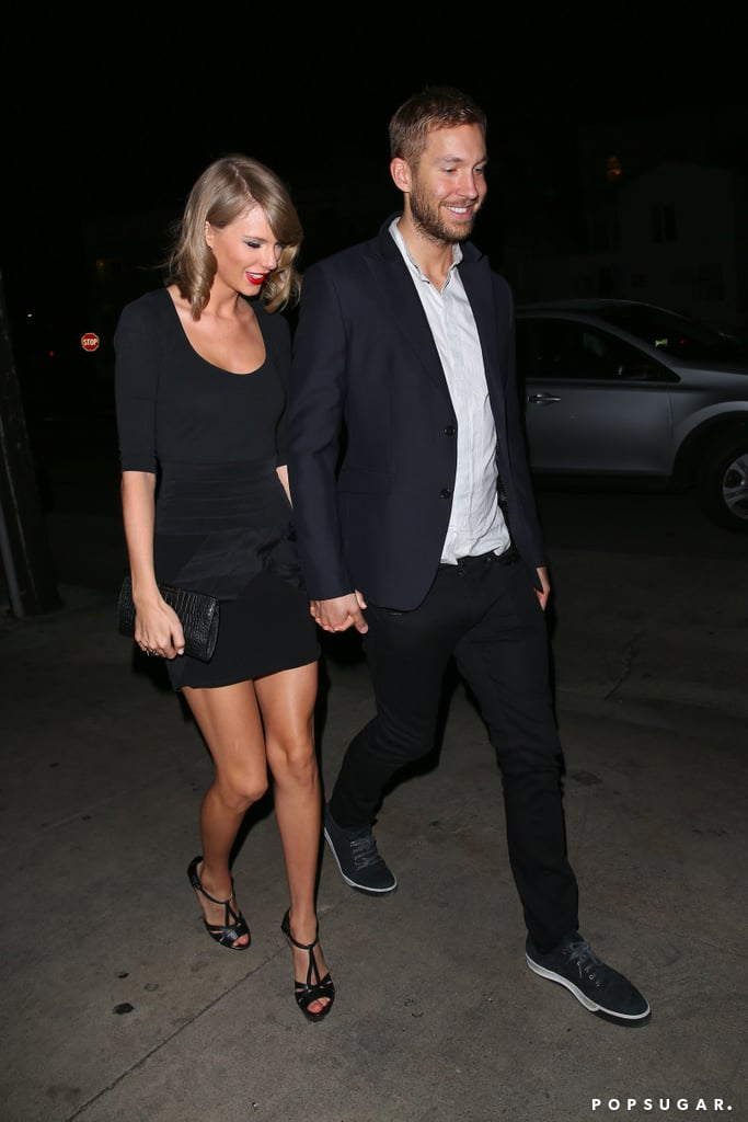 "Taylor Swift and Calvin Harris held hands for a date night in Venice, CA, on Tuesday. The duo dined at hot spot Gjelina and had huge grins on their faces as they wrapped up their evening. Taylor and Calvin were first rumored to be dating back in March, when they were spotted out together in Nashville, and since then they've shared multiple public outings including an April night out in LA and more recently a little PDA backstage at Calvin's Wango Tango show. Perhaps we'll see them take their relationship one step further this weekend at the Billboard Music Awards, where Taylor is set to premiere the video for ""Bad Blood."""