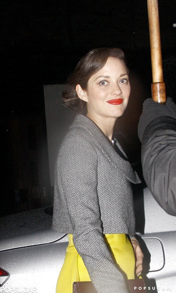 Marion Cotillard flashed a smile.