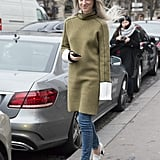 Elongate your figure with a turtleneck tunic, heels, and skinny jeans.