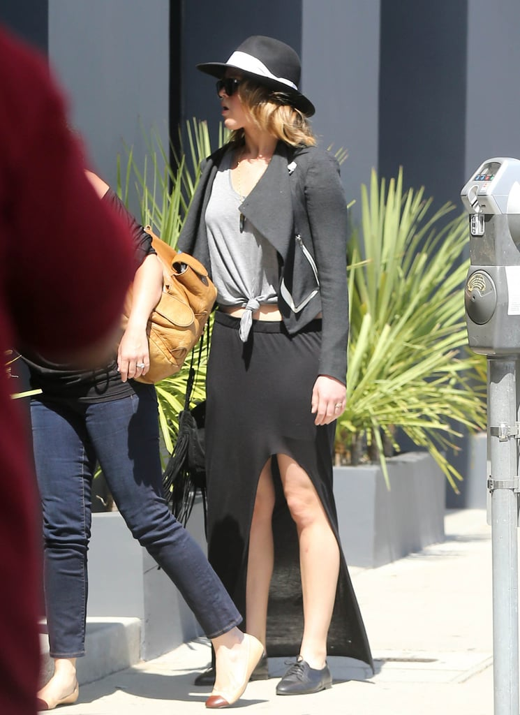 Jennifer Lawrence and a friend shopped at Vera Wang's LA boutique Saturday. As they left the shop, Jennifer's new lob haircut was on display, though partially obscured by her black hat, the finishing touch to her outfit, which included a knotted gray tee, fringed bag, and long black skirt. She's back in California following a stint in Boston, where she worked on American Hustle, the new David O. Russell movie, with Bradley Cooper and Jeremy Renner. Amy Adams and Christian Bale round out the cast in the film, which is the story of a 1970s financial scandal that brought down multiple members of Congress.