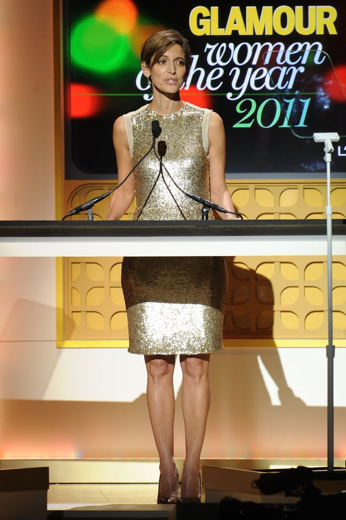 Cindi Leive wore a gold dress on stage.