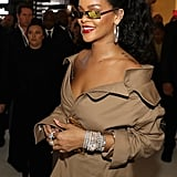 She accessorized with diamond jewelry, large hoops, and gold earrings.