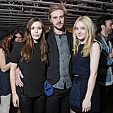 Actors Elizabeth Olsen, Boyd Holbrook, and Dakota Fanning posed for pictures at the Very Good Girls premiere afterparty.