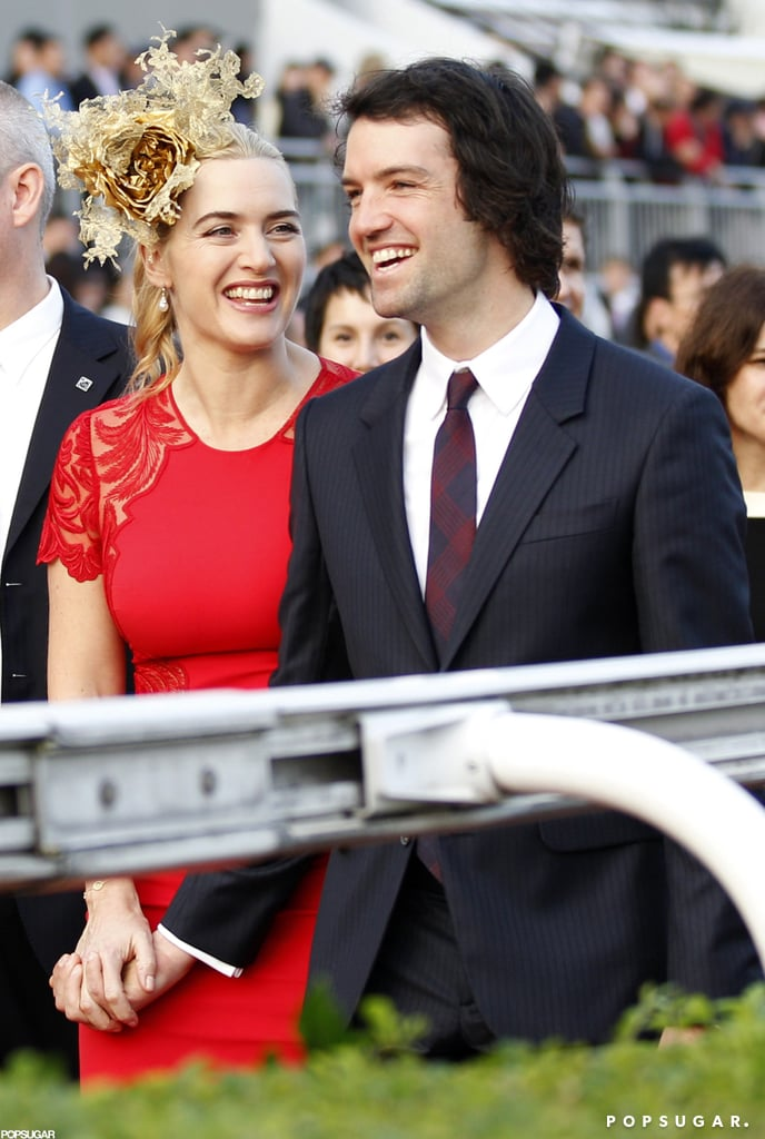 Kate Winslet had her boyfriend, Ned Rocknroll, on her arm yesterday at a horse race in Hong Kong. The actress, who wore a gorgeous gold fascinator and red dress to the event, honored the winning jockey in a ceremony following the races. Kate and Ned have been an item for a little more than a year, and over the weekend, looked very much in love as they linked arms to watch the jockeys compete for the win.  Kate was absent from the big screen in 2012, and when she returns, she'll be taking on a new challenge. In January, Kate will appear in the star-studded comedy Movie 43, alongside fellow actors including Emma Stone and Hugh Jackman. The raunchy, slapstick movie is a somewhat unexpected project for Kate, who holds the honor of being the youngest actress to have ever racked up two Academy Award nominations.