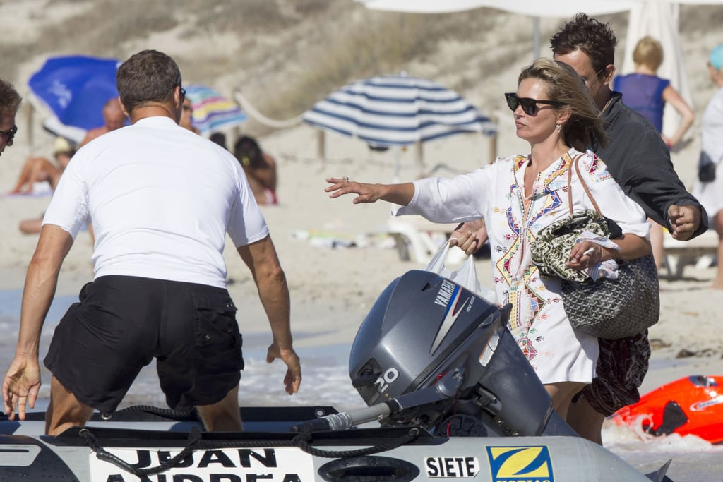 Kate Moss climbed on board an inflatable boat.