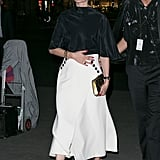 Hack: In the Fall, your white wrap skirt becomes eveningwear when you finish it with a satin high-neck blouse and a metallic clutch.