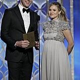 A very pregnant Kristen Bell presented alongside John Krasinski.