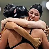 US swimmer Missy Franklin and her fellow teammates hugged it out after winning the 4x200m freestyle relay.