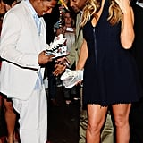 Mariah Carey and Nick Cannon took a look around at the Project Canvas Exhibition & Art Gala in NYC.