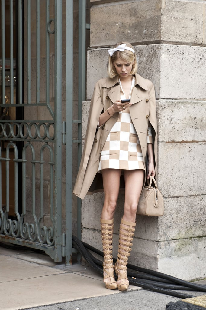 Elena Perminova juxtaposed her sweet style on top with gladiator-style sandal boots.