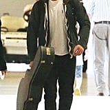 Robert Pattinson carried his guitar through the Melbourne airport.
