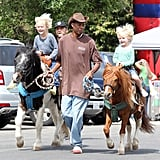 Liev Schreiber watched as his sons, Sasha and Kai, took a precious pony ride through an LA farmers market.