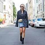 Cinch an oversize button-down over a miniskirt with a belt bag.