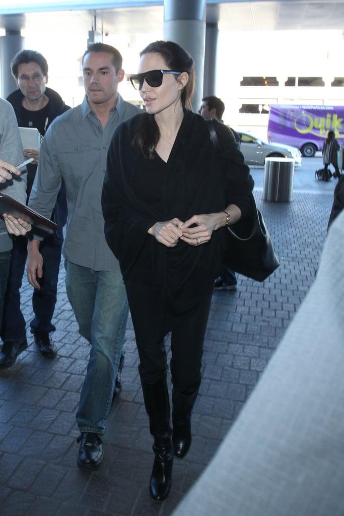 ee659e58b741 Wearing black square-shaped sunglasses. | Angelina Jolie Wearing ...