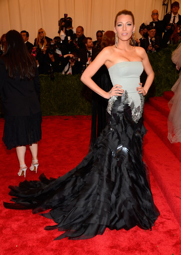 Blake Lively stunned in a Gucci frock on the Costume Institute Benefit red carpet at the Metropolitan Museum of Art in NYC. Blake is back in on the action after being notably absent from last year's ball in favour of a getaway to Vancouver with now-husband Ryan Reynolds. She is somewhat of a Met Gala vet, and Blake even stole the coveted role as Karl Lagerfeld's date while representing Chanel for the event back in 2011. Her return to the red carpet today is her first public appearance in months, and she certainly made a statement. What did you think of Blake's dress? Tell us which look was your favourite by voting in our Met Gala fashion and beauty polls!