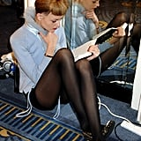 A model kept to herself with a book backstage ahead of the Kisa Spring/Summer 2008 fashion show during London Fashion Week.