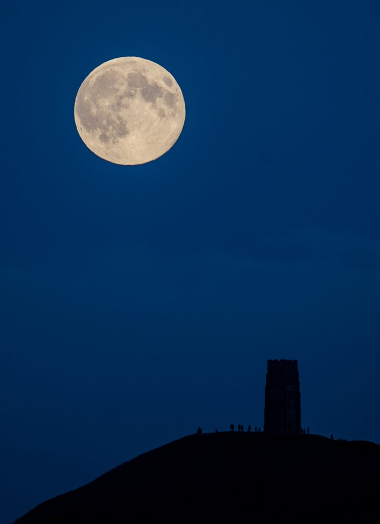 Looks fake, doesn't it? Here, on Aug. 10, the supermoon rises above Glastonbury Tor in Somerset, England.