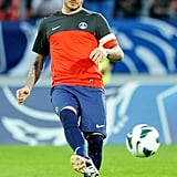 David Beckham warmed up prior to the French Cup football match in Paris.