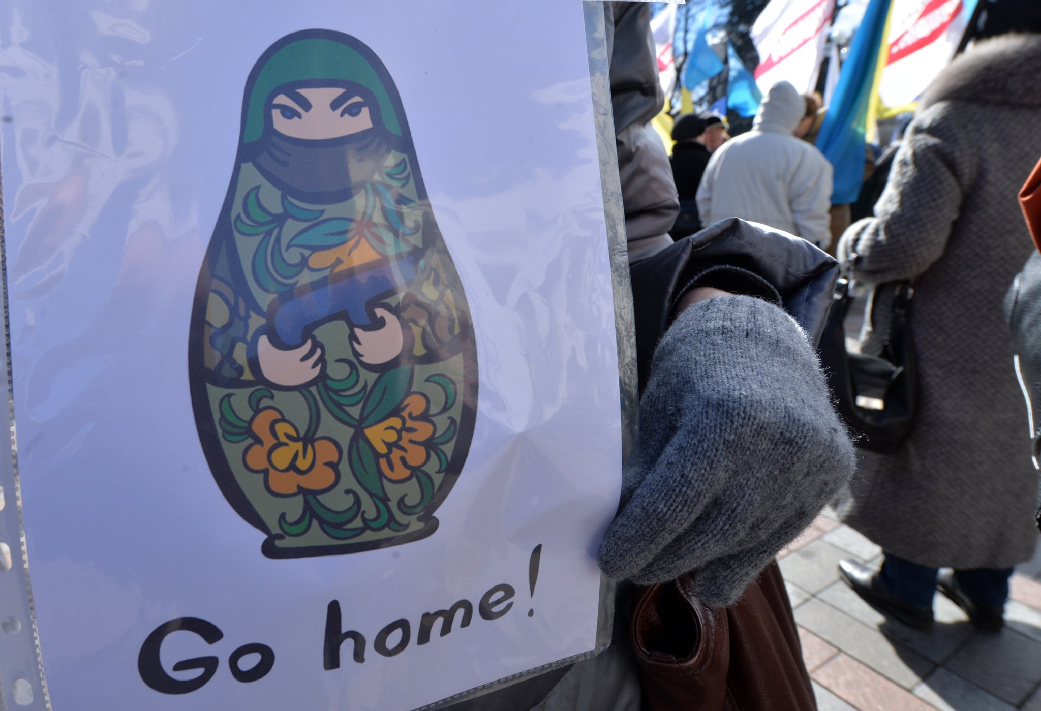 But obviously, not everyone was happy about the results. In Kiev on Monday, a woman held a sign telling Russia to go home, as Ukraine's defense minister said Ukrainian troops would remain in the peninsula.