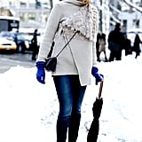 If your style is a little more undone, opt for an edgier fur-lined cape coat and sneaker wedges.