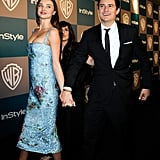 Model Miranda Kerr and Orlando Bloom don't let go heading into the InStyle party.