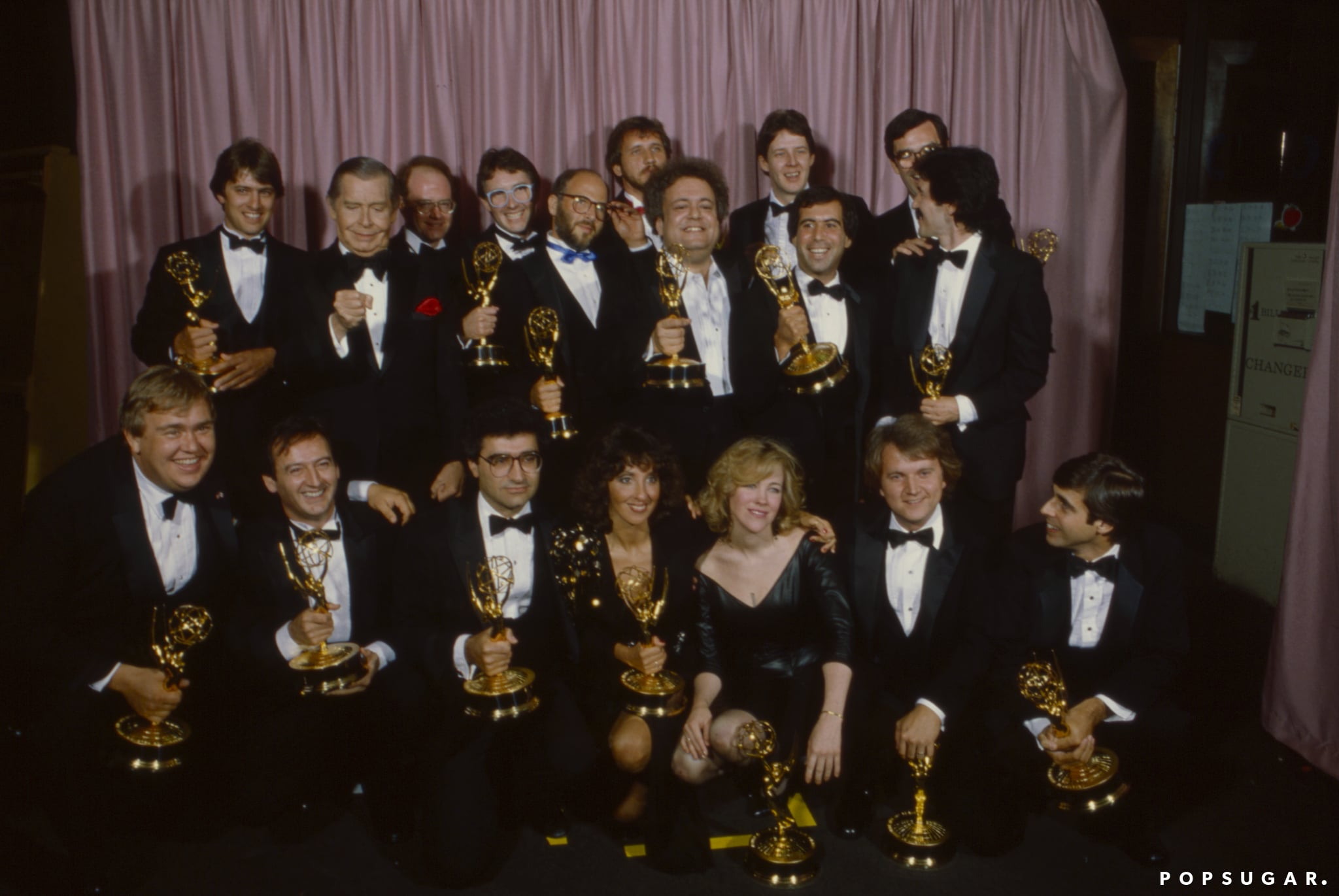 Pasadena, CA - 1982: (L-R) Milton Berle, John Candy, Joe Flaherty, Eugene Levy, Andrea Martin, Catherine O'Hara, Dave Thomas, SCTV crew and cast appearing at the 34th Primetime Emmy Awards, Pasadena Civic Auditorium, Pasadena, CA, September 19, 1982. (Photo by George Long /Walt Disney Television via Getty Images)