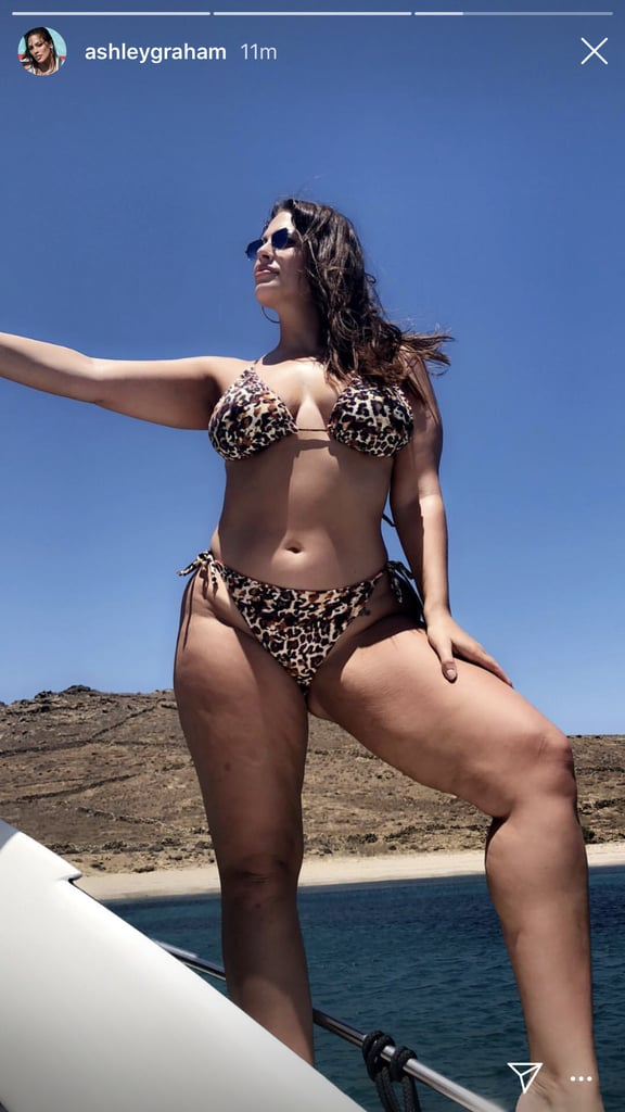 If you didn't realize, Ashley Graham loves a good leopard swimsuit! It doesn't matter if she's mixing and matching with pink bottoms or wearing a standout one-piece, Ashley loves to rock the bold print. The model knows exactly how to wear a swimsuit for her body, and her latest choice is no exception.  Ashley posted a photo on Instagram Stories rocking a very sexy leopard bikini from her Swimsuits For All collection while hanging out on a boat. The top and bottom are actually reversible, so you can rock the pink or leopard side. It's basically four bikinis in one! Homegirl was definitely feeling herself, and we don't blame her, because she looked amazing. The bikini fit her like a glove and perfectly accentuated her curves. Keep scrolling to shop similar options and possibly drool over Ashley in it.      Related:                                                                                                           Ashley Graham's 21 Sexiest Bikinigrams Deserve Your Full, Undivided Attention