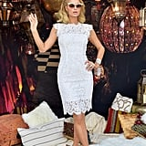 Paris Hilton wore a white lace dress and matching pumps.