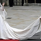 Wearing her custom Alexander McQueen wedding gown at the royal wedding in April 2011.