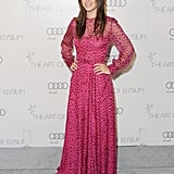 The bright pink leopard-print Valentino gown ($4,130, originally $5,900) Rachel Bilson wore to the Art of Elysium Gala is the perfect party piece, which is subtly revealing with its sheer panels.