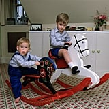 Prince William and Prince Harry played on their rocking horses at Kensington Palace together in October 1985.