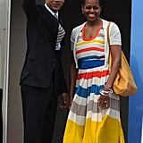 Michelle is colorful and by her man's side as they depart Brazil.