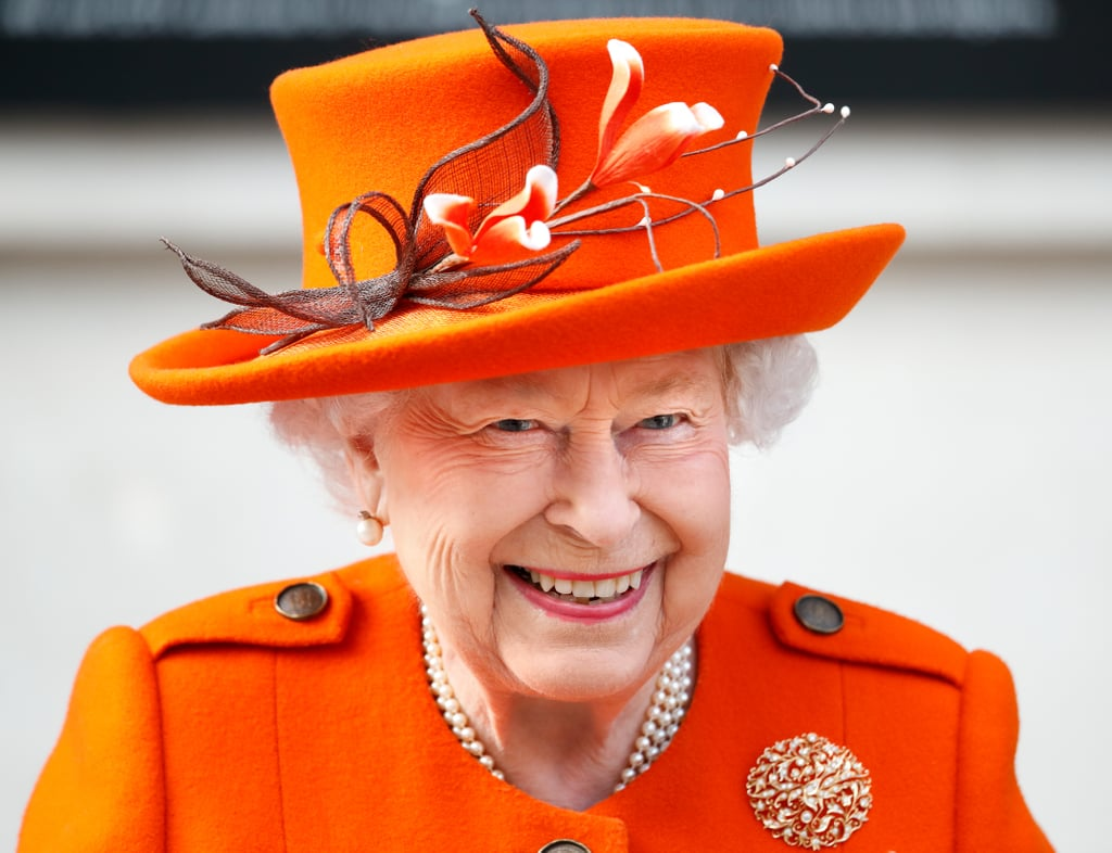 "Queen Elizabeth II is up on the trends. The 92-year-old royal recently stepped out wearing a monochromatic orange outfit reminiscent of the 2019 Pantone Colour of the Year, Living Coral. That same day, during a visit to the Science Museum, the queen shared her first-ever Instagram post from the royal family's official account. She'll be promoting hair-growth gummy-bear vitamins and teeth whitening products in no time! The queen paired her bright coat and beautiful hat with a teal floral-print dress, Gucci loafers, and a Launer handbag. In response to a question about the queen's famously bright wardrobe, her daughter-in-law Sophie, Countess of Wessex said she does it to stand out for members of the public looking on in a crowd. ""She needs to stand out for people to be able to say 'I saw the queen,'"" said Sophie. Something tells us that between her distinct look and usual entourage, however, the queen isn't too hard to spot.      Related:                                                                                                           The Sweet Story Behind Queen Elizabeth's Engagement Ring We Never Knew Until Now"