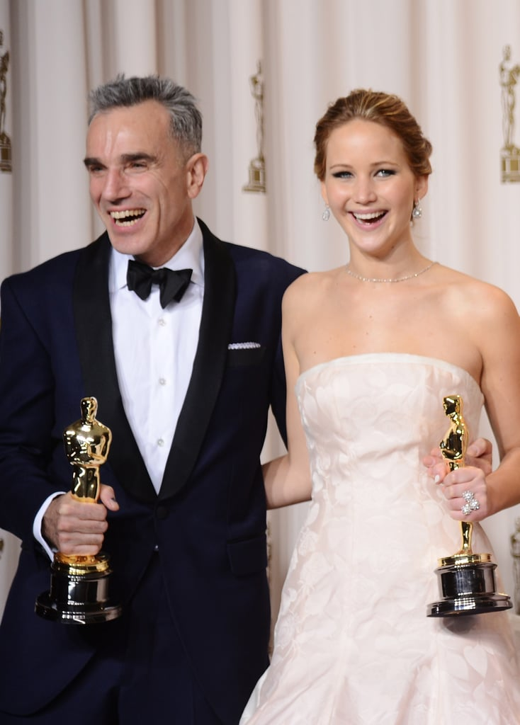 Daniel Day-Lewis and Jennifer Lawrence in the press room at the Oscars 2013.